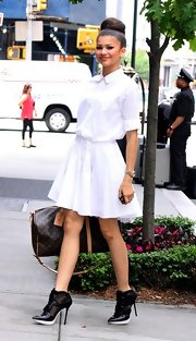 Zendaya Coleman chose a summery and playful white skirt dress for her daytime look while out in NYC.