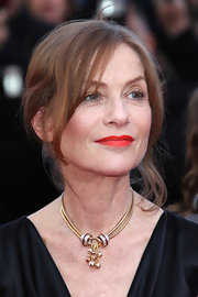 At the screening of 'The Tree of Life,' Isabelle Huppert opted for just one eye-catching accessory--a gold and diamond statement necklace.
