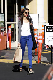 Zoe Saldana kept her outfit casual and chic in cobalt blue skinny jeans paired with black platform strappy sandals.