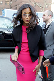Zoe Saldana didn't cover up too much of her hot pink dress with this cropped black jacket.