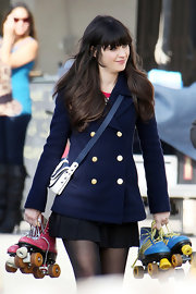 Zooey Deschanel put her own retro spin on a classic navy coat with the addition of a navy color-block satchel.