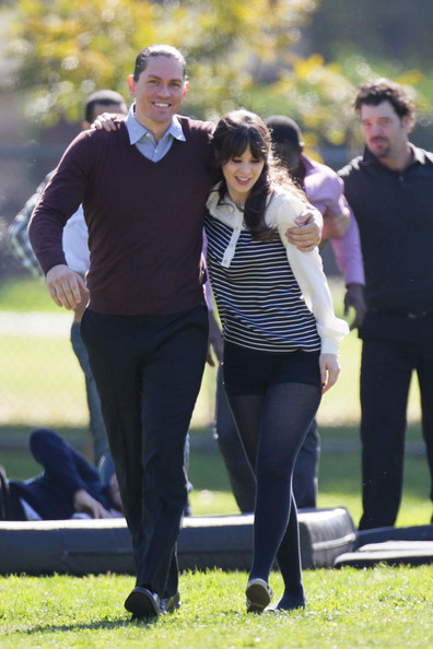 Steve Howey's V-neck sweater was casual and cool for both playing some football and filming 'New Girl.'