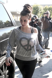 Kim Kardashian wore her hair in a voluminous knot while heading to the gym.