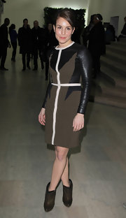 Noomi Rapace was edgy-chic at the Givenchy fashion show in brown ankle boots and a leather-panel dress.