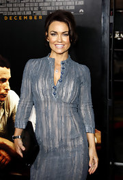 Kelly Carlson paired a chic blue dress with a oversize black YSL leather clutch.