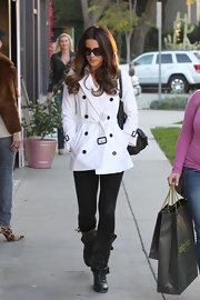 Kate Beckinsale went shopping in style in a classic white trench paired with black leather boots.