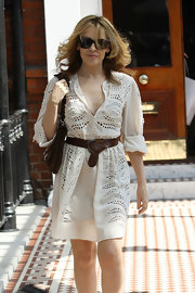 Kylie Minogue looks ready for spring in her cut-out cotton dress. She finished off her look with a wide leather belt, which she knotted at the waist.