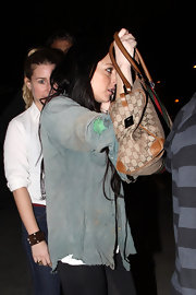 The tabloid queen shielded herself from the paps with her printed designer canvas bag.