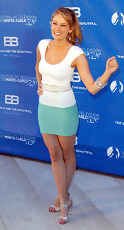Kim Matula made a perfect chic yet simple ensemble by wearing a white scoop-neck bandage shirt and a turquoise mini skirt.