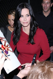Courtney Cox wore her long glossy hair in soft waves while on the set of 'Jimmy Kimmel Live.""