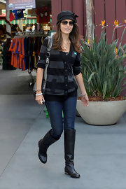 Camilla Belle donned casual flat knee high boots on a shopping excursion to the grove.