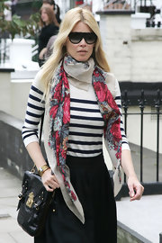 Claudia showed off her designer shield sunglasses while hitting London.