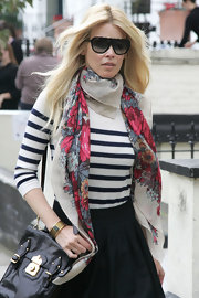Claudia paired her striped long sleeve shirt with a floral print scarf.