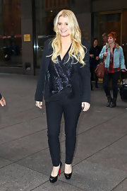Jessica Simpson donned timeless Louboutin platforms with a sleek black outfit. A sparkly sequin top adds wow factor the casual look.