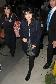 Zooey Deschanel wore this long navy coat for her appearance on 'Jimmy Kimmel Live.'