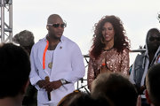Flo Rida added some spice to his monochromatic look with a white shirt with neon orange trim while visiting the 'Today Show' set in Miami.