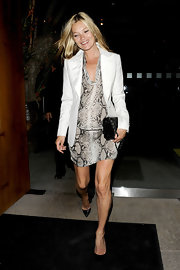 Kate Moss looked modelesque, as always, out and about in London wearing a snake print silk frock under a white blazer. Chic!