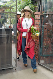 Brooke Mueller capped off her cowgirl look with a long red duster and leather accessories.