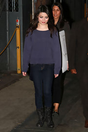 Miranda wears a cozy purple crewneck sweater with this casual ensemble.