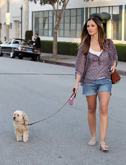 Minka Kelly took her dog for a walk in Beverly Hills in cream studded thong sandals.