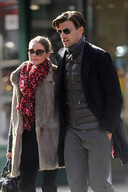 Olivia Palermo bundled up in a bright red and black patterned scarf while out to lunch with her beau.