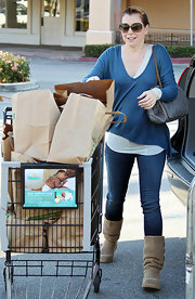 Alyson Hannigan kept cozy in a pair of slouchy knit boots.