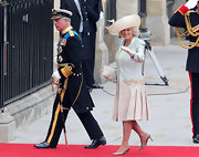 Camilla looked chic at the royal wedding in a pink and blue ombre dress coat with pleats.