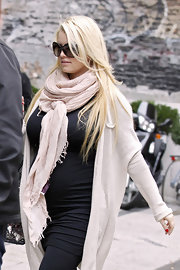 Jessica Simpson wore a soft pale pink pashmina with her draped cardigan for a chic maternity look while out in NYC.