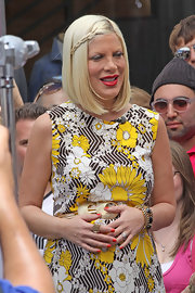 Tori Spelling styled her sleek bob with a sweet braided accent for an appearance on 'Extra.'