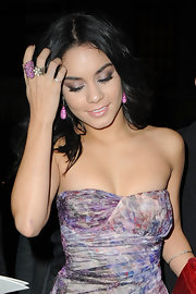 Vanessa Hudgens paired her gorgeous drop earrings with an 18-karat gold and blackened silver pink sapphire ring.