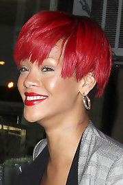 Rihanna has a new tattoo on her neck that reads rebelle fleur in stylish script. It looks good, but unfortunately it has a typo!