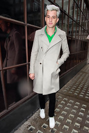 Mark Ronson stayed dry in the rain wearing a trench style beige wool coat.