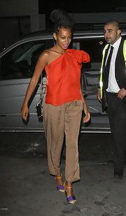 Solange Knowles went clubbing in London in a pair of on trend color block sandals. She teamed the purple and orange heels with billowy mocha pants and a silky orange tank.