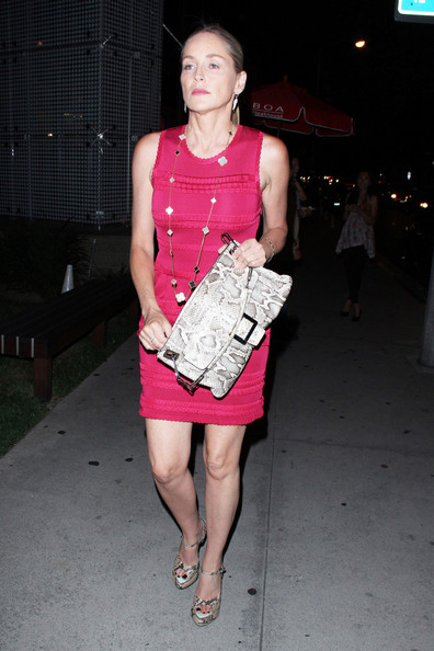 Sharon Stone gave her berry mini dress an exotic edge with snakeskin peep-toe pumps.