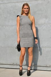 Bar was casual chic at Milan Fashion Week in a gray sheath dress with a subtle ruffled sleeve. She paired the look with black accessories and sleek tresses.