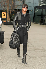 Kelly dons a leather clad wool coat while leaving the Heathrow airport.