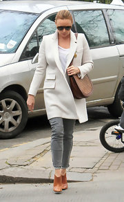 Stella McCartney paired her chic neutral ensemble with a brown woven satchel.