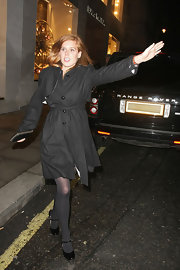 Princess Beatrice dons a black wrap wool coat while flagging down a cab in London.