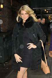 Kate Upton kept warm and stylish in a long black puffa jacket with fur trimming.