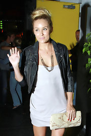 Lauren Conrad paired her cute leather jacket with a high top knot bun.