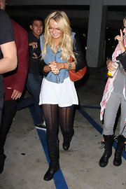 Lindsay wore textured tights with flat, knee-high boots.