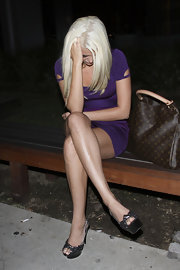 Karissa Shannon paired metallic platform peep-toes with a bandage dress for a date night with her boyfriend.