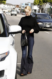 January Jones traveled light in LA with a small black leather satchel in tow.