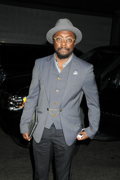 William Adams, aka will.i.am of The Black Eyed Peas, stops to pose with fans before heading into his midtown hotel in New York City