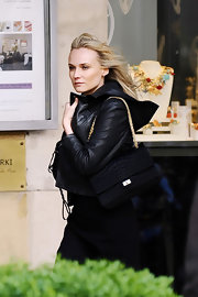 Diane Kruger filmed a L'Oreal commercial carrying an exotic black chain strap purse.