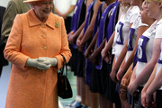 Queen Elizabeth II Dons a Tangerine Coat and Matching Hat