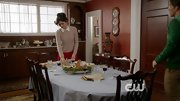 A classic crew neck sweater paired with a point-collared blouse made Katie Findlay's Thanksgiving dinner look extra classy on 'The Carrie Diaries.'