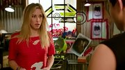 Gillian Zinser showed the punk side of her style in this torn red tee.