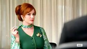 Christina Hendricks' red locks totally stood out against this emerald green printed blouse.