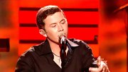 The cross necklace Scotty McCreery always wears has become so famous replicas are now being sold. True story.